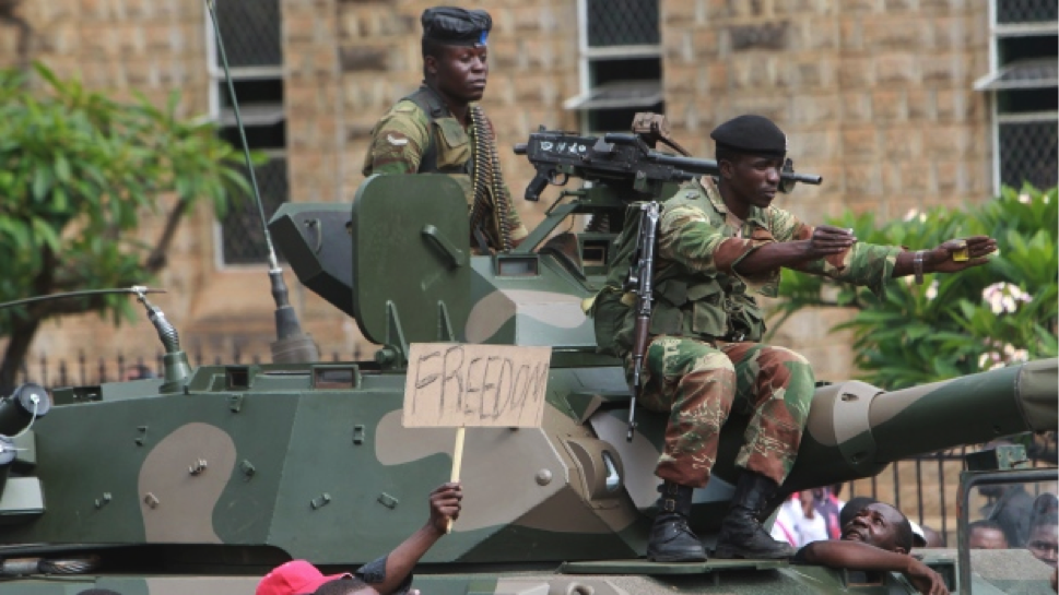 Soldiers on military tanks try to control a euphoric crowd marching on the streets of Harare, demanding the departure of President Robert Mugabe. (Tsvangirayi Mukwazhi/The Associated Press)