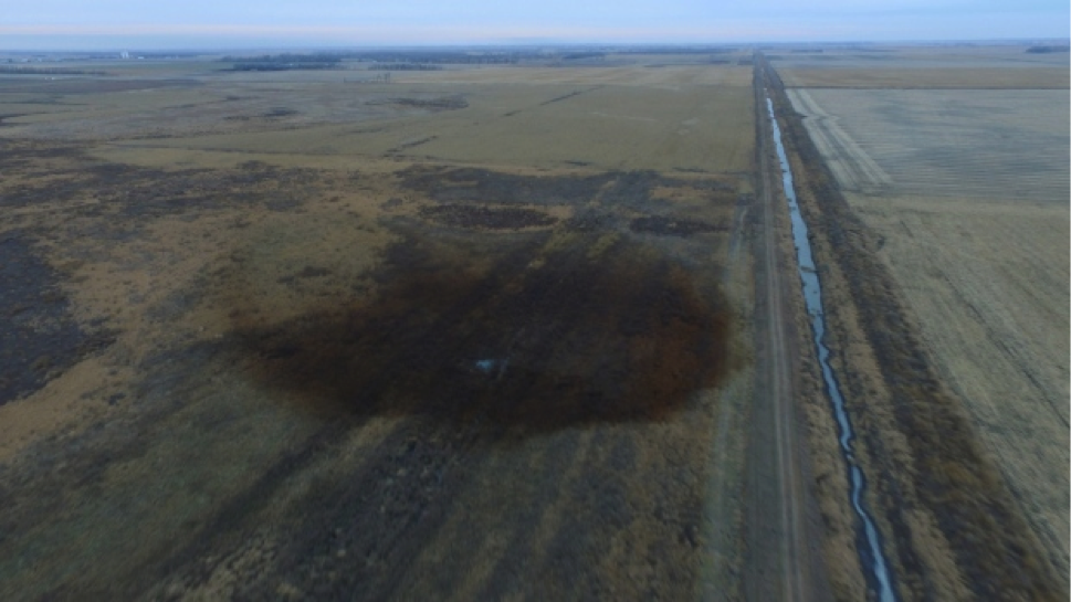 An aerial view shows the darkened ground of the oil spill that shut down the Keystone pipeline between Canada and the U.S., in an agricultural area near Amherst, South Dakota. (Courtesy DroneBase/Handout via Reuters)