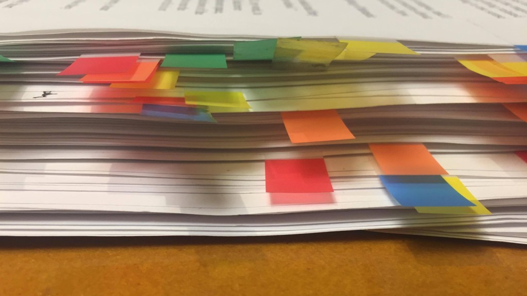 A stack of documents sifted through for this article.