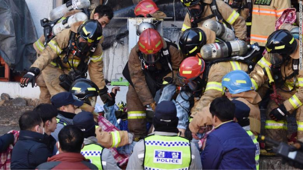 Rescue workers remove bodies from a hospital fire on Friday, Jan. 26, in Miryang, South Korea. (Courtesy CNN)