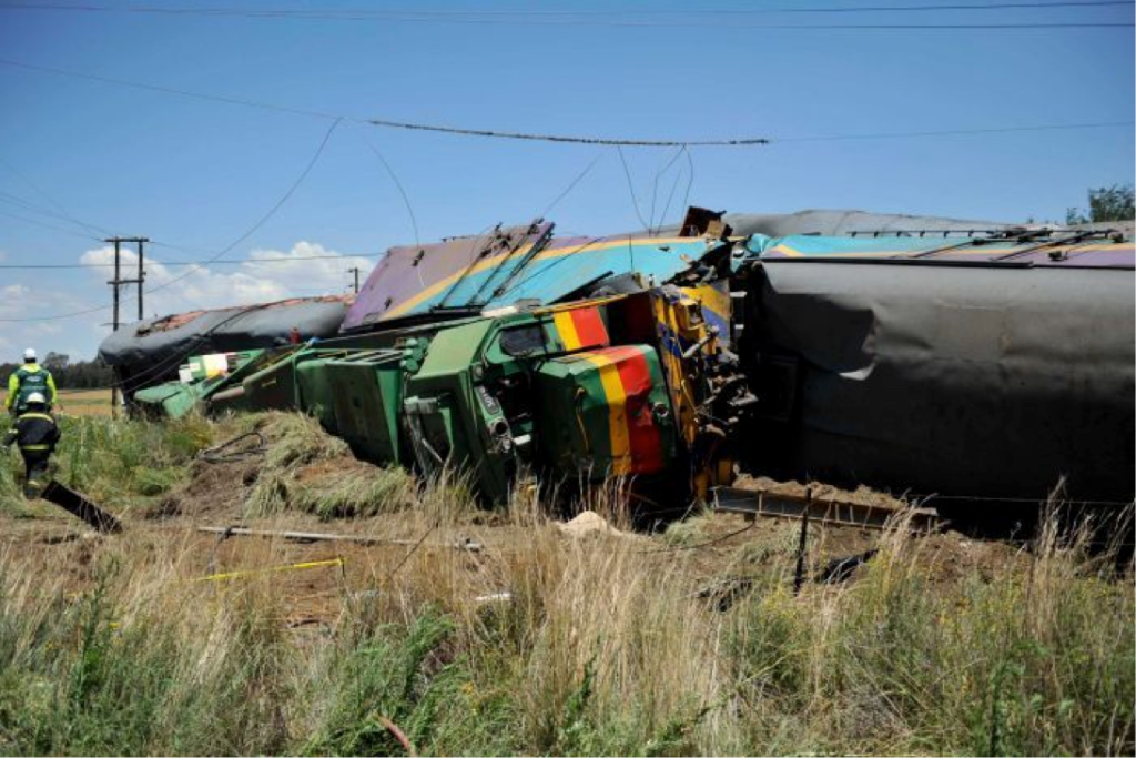 Emergency workers and ruined carriages at the scene of the accident near Kroonstad, South Africa (courtesy AP)