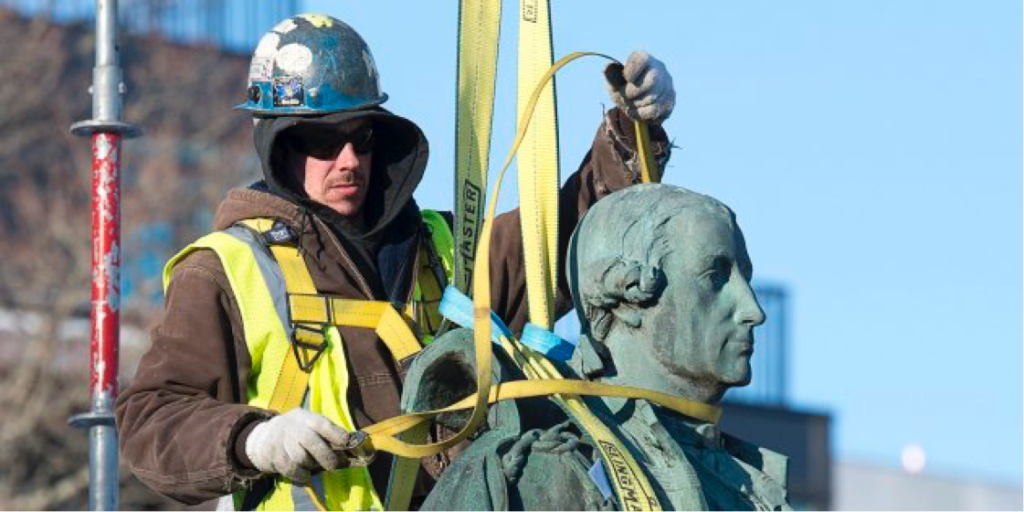Contractors remove the statue of Edward Cornwallis, a controversial historical figure, in a city park in Halifax on Jan. 31, 2018. (courtesy Andrew Vaughan/The Canadian Press)