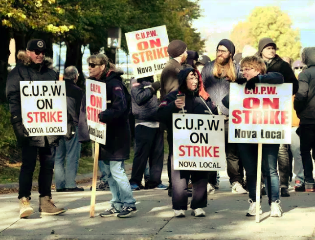 Canadian Union of Postal Workers (CUPW) members stand on picket line along Almon St., in front of the Canada Post regional sorting headquarters in Halifax on Monday, Oct.22, 2018 after a call for a series of rotating 24-hour strikes. Courtesy The Canadian Press/Ted Pritchard