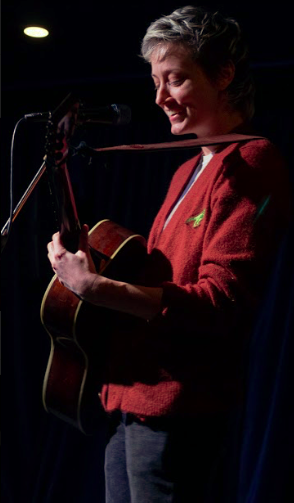 Mo Kenny laughing after joking about a bid war on EBay on stage at the Carleton on January 24, 2019. (Photo: Alec Martin)